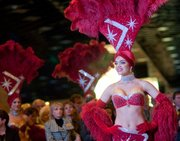 A Hollywood Casino Show Girl gets set to welcome visitors to the opening of the new Las Vegas-style casino at the Kansas Speedway, Friday, Feb. 3, 2012.