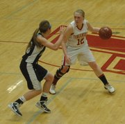 Tonganoxie's Amanda Holroyd dribbles against Mill Valley's Tanner Tripp.