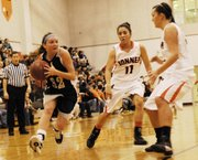 Mill Valley junior guard Tanner Tripp drives past Bonner Springs point guard Yessenia Hernandez. On Friday, the Jaguars ended Bonner Springs' perfect season and continued their own 13-game winning streak. Tripp led all scorers with 18 points.