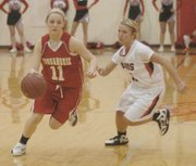 Emily Soetaert makes her way to the basket.