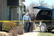 Johnson County Crime Lab technicians and Shawnee police officers were on hand much of Friday at 11601 W. 75th Terrace, where an early-morning fire killed two people. Fire officials said the fire only damaged one unit, and little fire damage was visible from outside the building. 