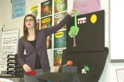 Kelly Hoopes runs through a vegetable murder mystery story Tuesday in Spanish 2 with the use of vegetables and felt cut-outs.