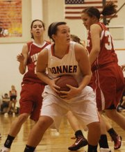 Senior Erin Marx grabs a rebound against Tonganoxie Saturday.