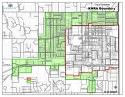 This map shows the boundaries of Shawnee's current downtown neighborhood revitalization district outlined in red, with the proposed expansion colored in green. Under the program, residential and commercial properties within the district are eligible for tax rebates if they make improvements that increase their properties' appraised values by at least $5,000.