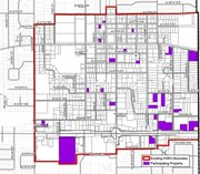 This map shows the boundaries of Shawnee's current downtown neighborhood revitalization district outlined in red, with participating properties shown in purple. Under the program, residential and commercial properties within the district are eligible for tax rebates if they make improvements that increase their properties' appraised values by at least $5,000.