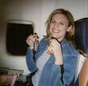 Louise Krug on an airplane to Jamaica in 2004, before her surgery and brain injury.