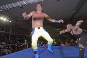 Jimmy Rockwell, left, gets tossed into the ropes by his opponent  during a recent Saturday night Metro Pro Wrestling match at Turner Recreation Center in Kansas City, Kan.