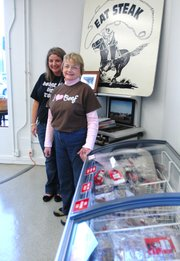 Dodge City Beef moved this month from 11115 Johnson Drive to a larger retail space a few doors down, inside the former Commerce Bank building at the corner of Johnson Drive and Nieman Road. Heidi Hullman-Davis (left), Olathe, manages the store. Her mother, LuAnn Hullman, Pratt, helped out on a recent afternoon. The store sells beef raised on the Hullman family ranch in Pratt.