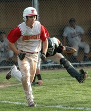 Senior Austin Harkrader tries to beat out a bunt.