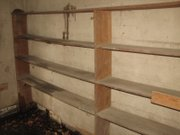 Wooden shelves about five feet high line the walls of the old Reuben Basehor Library.