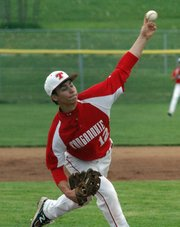Senior Austin Harkrader delivers a pitch in the first inning.
