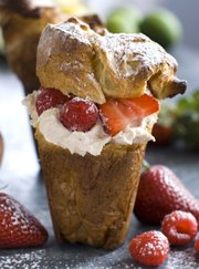 Cardamom popovers with cinnamon mascarpone and berries make for a quick and simple springtime dessert. The recipe also does double-duty  leftover popovers can be served the next morning with jam and butter for breakfast. 