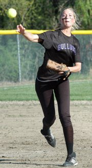 Senior Morgan Drinnon fires to first base after a ground ball.