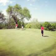 In a photo taken using the mobile app, Instagram, high school golfers assemble before a putt at the Lake Quivira Country Club during Shawnee Mission Northwest's annual invitational on Monday.