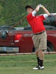 Kody Campbell watches his shot off the tee.
