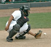 Gonzalo Pichardo hauls in a pitch behind the plate.