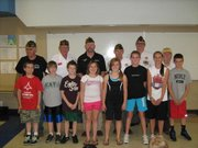 Basehor VFW Post members with Basehor Intermediate School fifth-graders.