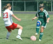 Basehor-Linwood's Megan Sixta tries to keep the ball away from Tonganoxie's Madison Simmons.