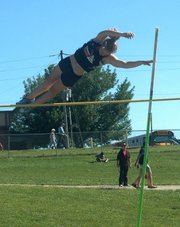 Bethany Bailey clears the bar in the pole vault Wednesday at the KVL track and field meet. Bailey took second in the event with a jump of 10 feet.