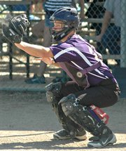 Calvin Booth hauls in a pitch behind the plate.