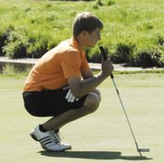 Bonner Springs junior Tristan Abts prepares for a putt on the back nine at the KVL golf tournament on May 9 in Lawrence. Abts improved on his 43 score on the front nine at Eagle Bend with a 39 on the back nine.