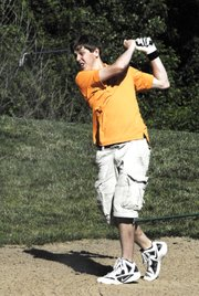 Bonner Springs junior Jason Van Maren works his way out of a sand pit on the back nine at the KVL tournament in Lawrence on Wednesday, May 9.