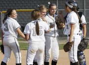 The Mill Valley softball team meets in the infield before first pitch against Turner on Monday.