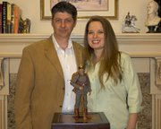 Steve and Margaret Allen, owners of Timewalker Toys & Collectibles, pose with their World War I toy prototype.