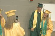 Tanner Schoepflin and Marissa Dove have their photo snapped before Basehor-Linwood High School's 2012 commencement May 17.