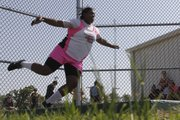 Shawnee Mission Norths Whitney Harvey pivots before throwing the discus in the 6A regional track meet Friday at Lawrence Free State high school.