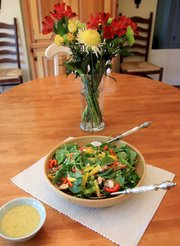 Ivy Travis' recipe for spinach salad, which she got from her late mother-in-law, is a Memorial Day staple for the family. The colorful recipe calls for fresh spinach, sweet peppers, mushrooms, bacon, eggs and a mustard-vinegar dressing.