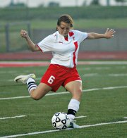 Aly Bartholomew clears a ball against Hayden.