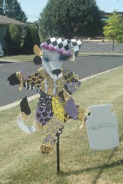 An intricately decorated cow featuring the school colors of Linwood Elementary School sits in front of the Basehor-Linwood district offices on 155th Street.