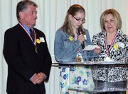 Kira McDaniel, center, is flanked by Dave and Marcia Mielke, whom Kira nominated for Kindest Kansas Citian awards.