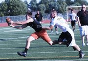 BSHS senior Mason Roberts, left, reaches to bring in a catch while BLHS senior Tanner Garver defends him during Monday's 7-on-7 league game at Basehor-Linwood.