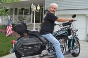 Tom Steele of Basehor says he'd rather spend his time on his Harley or with grandkids than frittering it away on the Internet.