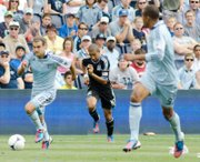 Midfielder Graham Zusi recorded his eighth assist, tied for first in the MLS, with his corner kick feed to Julio Cesar Saturday.