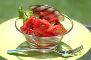 A citrus-mint dressing balances charcoal-kissed watermelon in this Grilled Watermelon Salad.