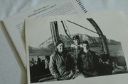 Among Gene Ward&#39;s war artifacts is a photo of himself, his crew&#39;s radio operator Paul Hadley, and another unidentified soldier (from left) while the crew was on R&amp;R at the Isle of Capri, shown in the background.
