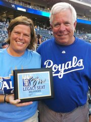 Susan Mayberry and Ron Grover with the Buck O'Neil Legacy Seat plaque. Grover, a former Basehor-Linwood school board member who now shares his story of being the parent of a recovering addict, nominated Mayberry for an award that later caught the Royals' attention.