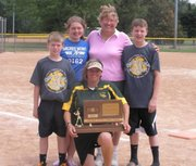 Mary Nutter celebrates the Basehor-Linwood softball team's third-place trophy in May.