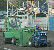 Jett Courtois maintains a steady pace on his tractor, &quot;Cub Ca-Jett.&quot;