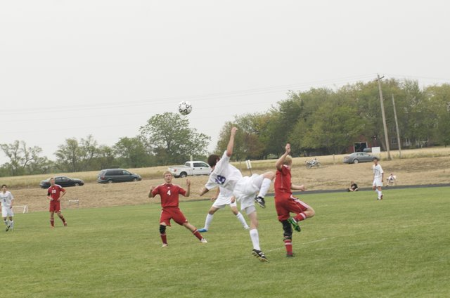 Baldwin and Tonganoxie players battle for control of the ball in the first half of Friday's opening soccer match from both teams. Baldwin won the hard-fought match, 2-1.