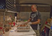Truebud BBQ pitmaster Tim Grant, Tonganoxie, cleans up extra brisket after the last meat turn-in of the Smokin' on Oak barbecue competition Aug. 25, 2012, in Bonner Springs. Truebud is one of the top barbecue teams in the country right now, hanging in the top 10 of the Kansas City Barbeque Society's Team of the Year points chase.