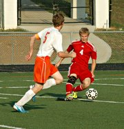 Sophomore Asher Huseman keeps the ball away from a Bonner Springs defender.