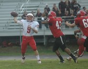 Junior Tyler Ford throws a screen pass to a receiver. Ford completed five of his 11 passing attempts.