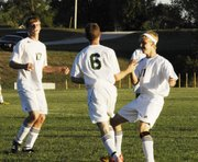BLHS senior Trey Kincheloe (6) celebrates his first of three goals against Immaculata on Monday. Joining him is junior Sean Potter (17) and senior Dustin Denham (11).