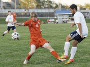 BSHS freshman Jacob Kraus makes a play against Mill Valley junior Cody Knight on Tuesday, Sept. 11.