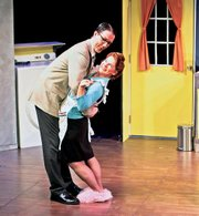 "Brian and Cinnamon perform together in the play ""Absurd Person Singular,"" by Alan Ayckbourn, staged in 2005 by the Kansas City Actors Theatre."