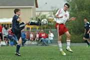 John Lean braces for impact from a ball off the foot of Mill Valley's Cody Knight.